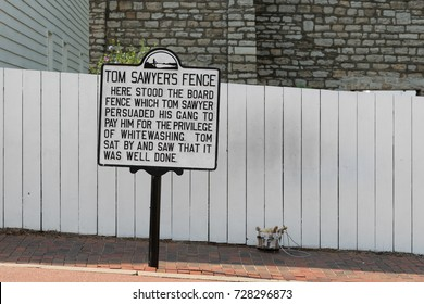 HANNIBAL, MISSOURI - AUGUST 14: Tom Sawyer's fence next to Mark Twain's boyhood home on Main Street on August 14, 2017 in Hannibal, Missouri