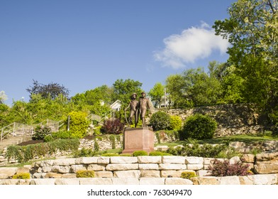 HANNIBAL, MISSOURI - MAY 15: Bronze statue of Mark Twain's fictional characters, Tom Sawyer and Huckleberry Finn, on MAY 15, 2016 in Hannibal, Missouri