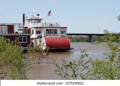 Hannibal Mo. USA  12.may2008. The Mark Twain Excursion Boat awaits tourists at the Mississippy Harbor. The writer was born in the city and the bridge across the river also bears his name
