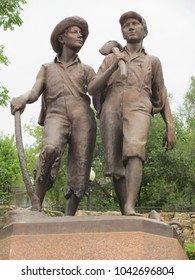 Hannibal, MO / USA - Sept 10, 2015: This statue of Tom Sawyer and Huck Finn resides in Mark Twain's hometown of Hannibal, MO, on the banks of the Mississippi River.