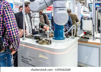 HANNOVER / GERMANY - APRIL 02 2019 : Staubli is presenting the newest generation of cobots - Collaborative robots - and HGVs at the HANNOVER FAIR.