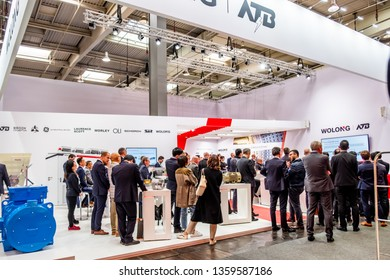 HANNOVER / GERMANY - APRIL 02 2019 : Wolong is presenting the newest generation of cobots - Collaborative robots - and HGVs at the HANNOVER FAIR.