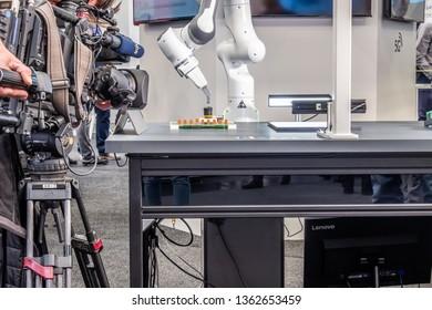 HANNOVER / GERMANY - APRIL 02 2019 :NDR camera team recording robot