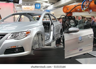 HANNOVER, GERMANY - APRIL 19: demonstration of an industrial handling robot fitting the doors to a car , Hannover Messe April 19, 2010 in Hannover, germany