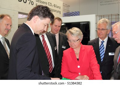 HANNOVER, GERMANY - APRIL 19: german minister of education and research prof. dr. Anette Schavan is given information on newest research results, Hannover Messe April 19, 2010 in Hannover, germany