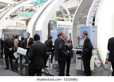HANNOVER, GERMANY - APRIL 19:people on the stand of Siemens at the hannover industrial fair , Hannover Messe, April 19, 2010 in Hannover, germany