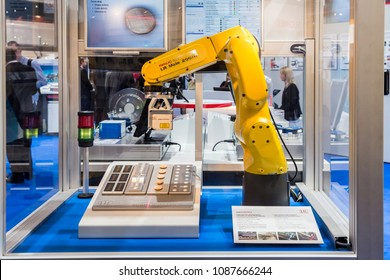 Hannover, Germany - April, 2018: Automatic Industrial Robot Fanuc LR Mate 200 iD and laser scanner with integrated controller for 2D/3D scans on Messe fair in Hannover, Germany