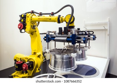 Hannover, Germany - April, 2018: Automatic Industrial Robot Fanuc R-2000iB concept auto service working process on Messe fair in Hannover, Germany