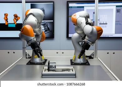 Hannover, Germany - April, 2018: Future of automation, autonomous system with Kuka robots on Siemens stand on Messe fair in Hannover, Germany
