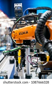 Hannover, Germany - April, 2018: Kuka robot on Schunk assembly electronics line on Messe fair in Hannover, Germany