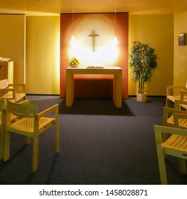 Hannover, Germany, July 17., 2019: View of the Christian chapel in the airport with wooden chairs and a simple altar for prayer and reading the Bible.