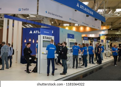 Hannover, Germany - June 13, 2018: Booth of the company Atlassian with employees and fair visitors at CeBIT 2018. CeBIT is the world's largest trade fair for information technology.