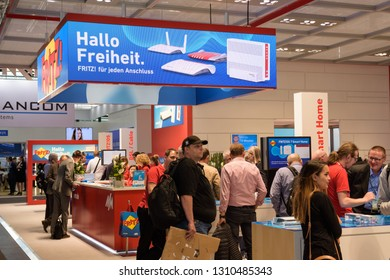Hannover, Germany - June 13, 2018: Booth of the company AVM with fair visitors at CeBIT 2018. CeBIT is the world's largest trade fair for information technology.