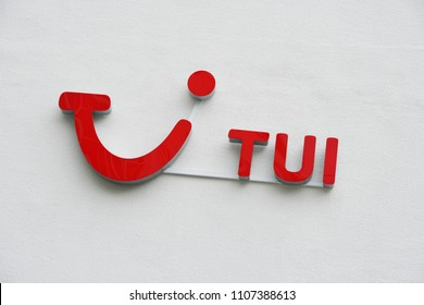 Hannover, Germany - June 6, 2018: TUI logo and brand sign on wall. TUI Group is the largest travel and tourism company in the world, headquartered in Hannover.