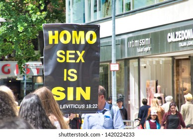 "Hannover, Germany, June 8., 2019: Poster of a Christian conservative group protesting with the slogan ""Homo Sex is Sin"" against the Christopher Streets Day"