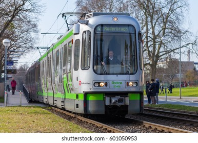 HANNOVER / GERMANY - MARCH 12, 2017: german tram from UESTRA drives to the next stop. UESTRA is the operator of public transport in the city of Hanover, Germany