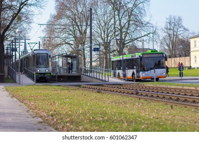 HANNOVER / GERMANY - MARCH 12, 2017: regular bus and tram from UESTRA drives on route to the next stop. UESTRA is the operator of public transport in the city of Hanover, Germany
