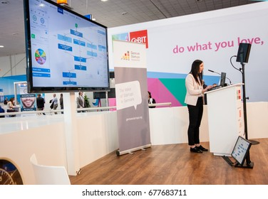 HANNOVER, GERMANY - MARCH 14, 2016: Unidentified young woman makes presentation at Startup Stage lecture hall of German Startup Association at CeBIT trade show in Hannover, Germany on March 14, 2016.