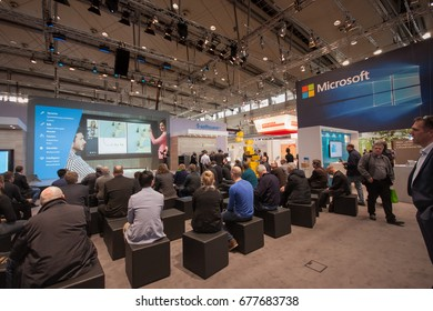 HANNOVER, GERMANY - MARCH 14, 2016: People listen presentation in booth of Microsoft company at CeBIT information technology trade show in Hannover, Germany on March 14, 2016.