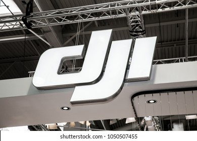 Hannover, Germany - March, 2017: DJI company logo sign on exhibition fair Cebit 2017 in Hannover Messe, Germany