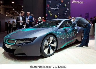 Hannover, Germany - March, 2017: Self-driving BMW i8 Roadster and virtual reality Microsoft HoloLens by IBM company on exhibition fair Cebit 2017 in Hannover Messe, Germany