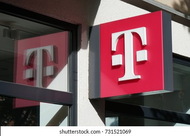 Hannover, Germany - October 8, 2017: T logo at German telecommunications company Telekom Deutschland chain store at Lister Meile.