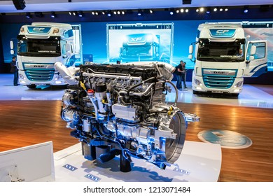 HANNOVER, GERMANY - SEP 27, 2018: Modern truck engine in front of new DAF trucks at the Hannover IAA Commercial Vehicles Motor Show.
