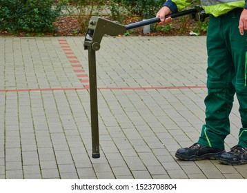 Hannover, Germany, September 16., 2019: Search of dud bombs and bombs from the Second World War with the magnetometer probe on a paved surface