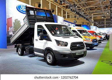 Hannover, Germany - September, 19, 2018: Ford Transit commercial vehicles in the row during presentation on IAA motor show.