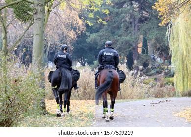 Hannover, Germany-01 December 2019; Policemen patrol on horseback at the Rathaus (city hall) garden