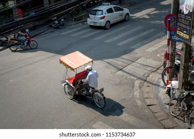 Hanoi capital, Vietnam - July 12, 2018: Cyclo or pedicab driver on Hanoi street. Cyclo is one of the most favorite vehicles for tourist when coming to Vietnam's cities.