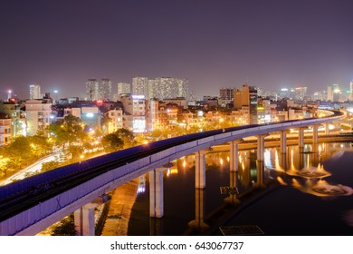 Hanoi cityscape at twilight with the building reflection in lake