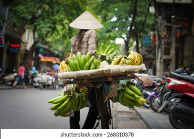 Hanoi fruit vendor with vignette effect added