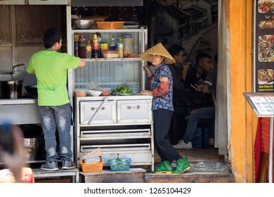 Hanoi, Hoam Kiem, Vietnam - 12/28/2018:  Traditional restaurant in Old Quarters Hanoi. Improvised living room eateries offer everything from  spring rolls to beef soup.