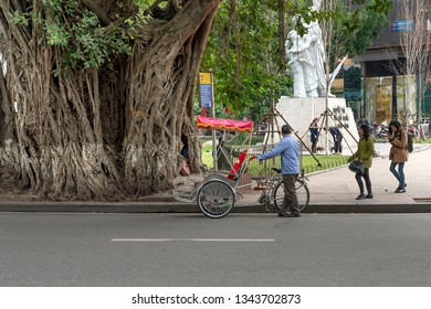 Hanoi Old Quarter, Vietnam, January 3, 2019: A Vietnamese cyclo parked by the roadside in Hanoi Old Quarter street.  Cyclo is transportation favorite for visiting Hanoi Old Quarter