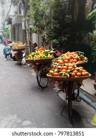 Hanoi Old Quater. Street Vendoring. Fresh Mandarin Oranges in Bamboo Baskets on a Bike.