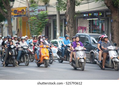 Hanoi Vietam November 29  2016 Life in Vietnam - Street by moto bike is an essential part of life in Vietnam, traffic of Asian city in rush hour, of people in motorcycles.