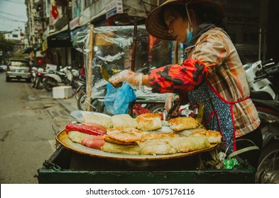 Hanoi, Hanoi/ Vietnam - 12 31 2017: a food stall selling fried Chung cake on the street in Hanoi, Vietnam.