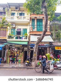 HANOI, VIETNAM - 19TH MARCH 2017: Views along streets in Hanoi Vietnam during the day. The outside of buildings and people can be seen.