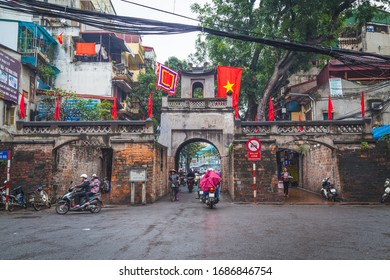HANOI, VIETNAM - 19TH MARCH 2017: The Quan Chuong City Gate in Hanoi Old Quarter during the day. People can be seen.