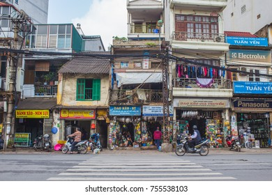 HANOI, VIETNAM - 19TH MARCH 2017: The outside of buildings in central Hanoi during the day.  Shops and people can be seen.