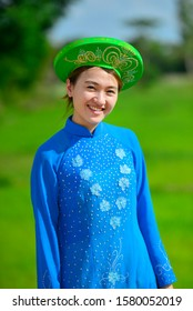 Hanoi, Vietnam, 2006 : Vietnamese lady in her national dress and beautiful hat, she wearing this costume in important ceremony or annual festival. Tourist can buy this dress as a souvenirs.