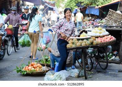 Hanoi, Vietnam - 21 October 2016: Market trader selling fruit from bicycle. Hanoi, Vietnam