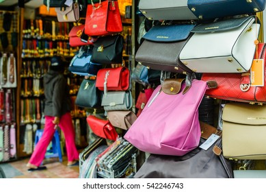 Hanoi, Vietnam 29 November 2016: Fashion bags, fake models of most well known luxury brands from China for selling at Hang dao street in Hanoi