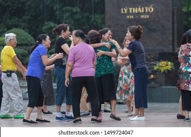 Hanoi, Vietnam. 7 October 2018: Laughter is the best medicine. Vietnamese doing the laughter yoga in the park near Hoan Kiem lake, Hanoi.