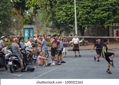 Hanoi, Vietnam. 7 October 2018. Locals playing Chinese game of Jianzi with a colorful shuttercock in Hoan Kiem, Hanoi. Money betting are involved in this game by the spectators.