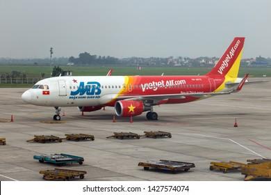 HANOI, VIETNAM, APR 19 2019, The air plane VietJet Air company stands at the Noi Bai International Airport.