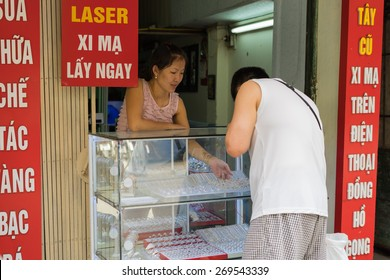 Hanoi, Vietnam - Apr 5, 2015: People buying jewelry in a gold & silver store in Hang Bac street, Hoan Kiem district