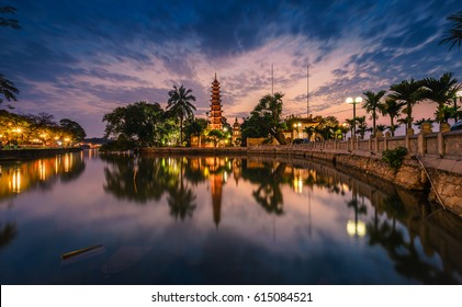 HANOI, VIETNAM - APRIL 01, 2017: Tran Quoc pagoda in sunset in Hanoi, Vietnam. This pagoda is located on a small island near the southeastern shore of West Lake.