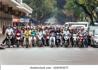 HANOI, VIETNAM. APRIL 10, 2016: Motorcycles got traffic jam on the road with green trees in background at Hanoi, Vietnam.